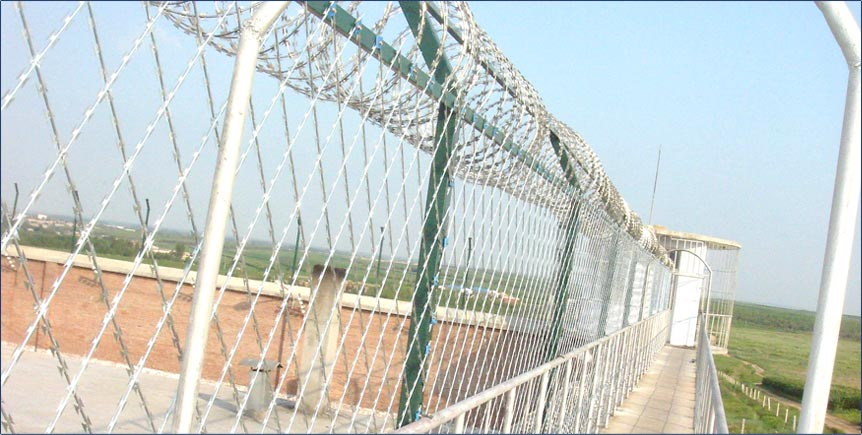 Razor barbed wire and fence